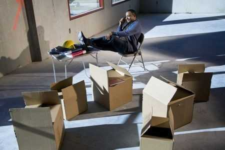 commercial movers in office interior with boxes